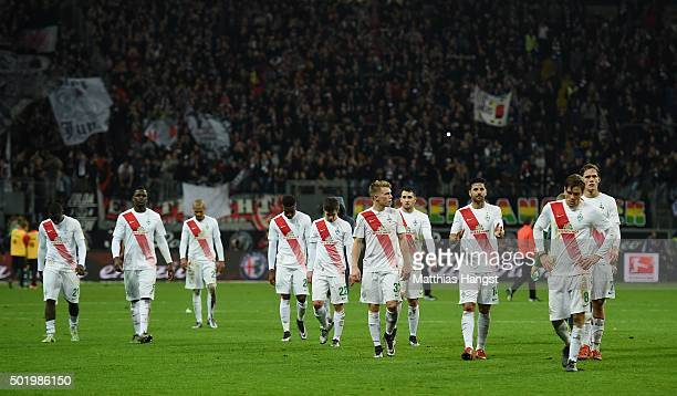 The players of Bremen walk to their fans after the Bundesliga match between Eintracht Frankfurt and Werder Bremen at CommerzbankArena on December 19...