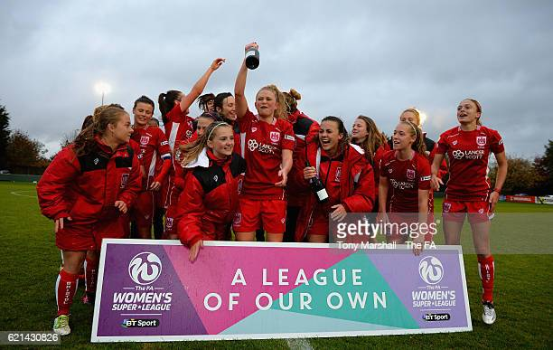 The players of Bristol City Women celebrate their promotion to WSL1 during the FA WSL 2 match between Oxford United Women FC v Bristol City Women FC...