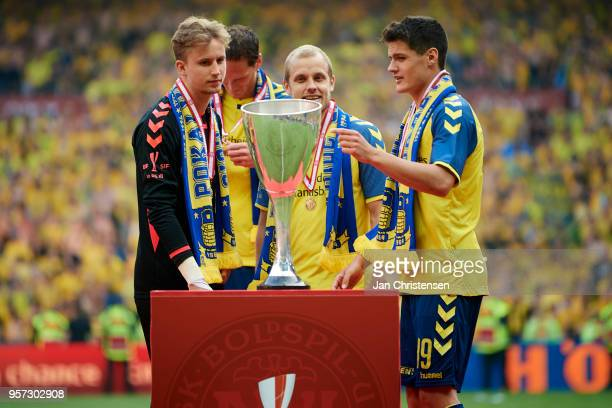 The players of Brondby celebrate at the podium after the Danish Cup Final DBU Pokalen match between Brondby IF and Silkeborg IF at Telia Parken...