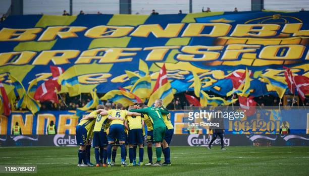 The players of Brondby huddle in front of the fans during the Danish 3F Superliga match between FC Copenhagen and Brondby IF at Telia Parken on...