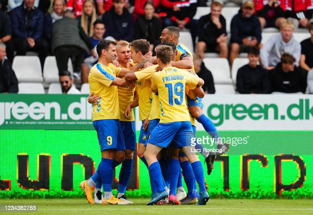 The players of Brondby IF celebrate after the 0-1 goal scored by Mikael Uhre of Brondby IF during the Danish 3F Superliga match between Vejle...