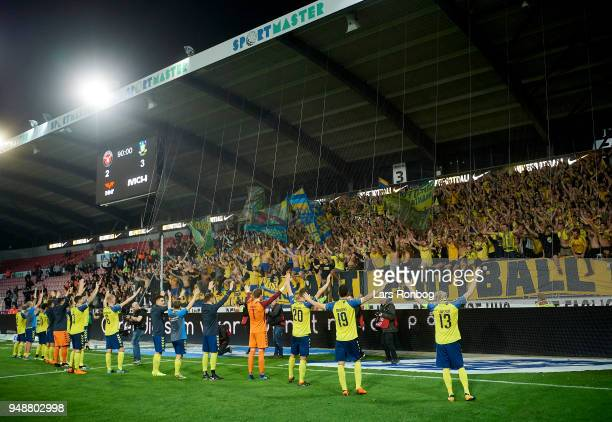 The players of Brondby IF celebrate with the fans after the Danish Alka Superliga match between FC Midtjylland and Brondby IF at MCH Arena on April...