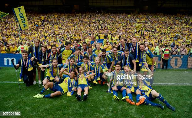 The players of Brondby IF celebrate with the trophy winning the cupfinal after the Danish DBU Pokalen Cup Final match between Brondby IF and...