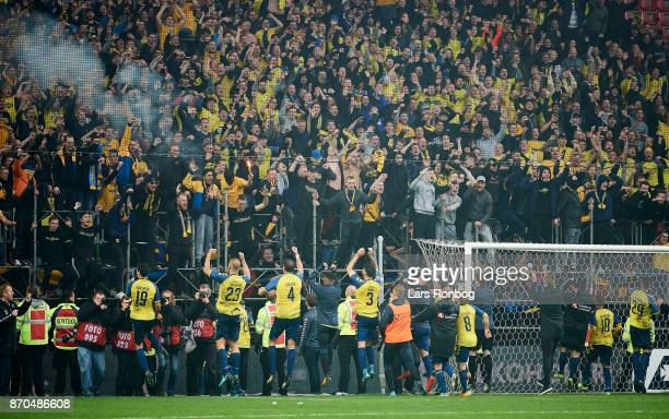 The players of Brondby IF celebrate withy the fans after the Danish Alka Superliga match between FC Copenhagen and Brondby IF at Telia Parken Stadium...