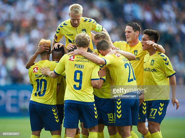 The players of Brondby IF celebrating the 03 goal from Andrew Hjulsager during the Danish Alka Superliga match between AGF Arhus and Brondby IF at...