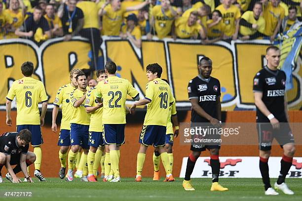 The players of Brondby IF celebrating the 22 goal from Alexander Szymanowski during the Danish Alka Superliga match between FC Midtjylland and...