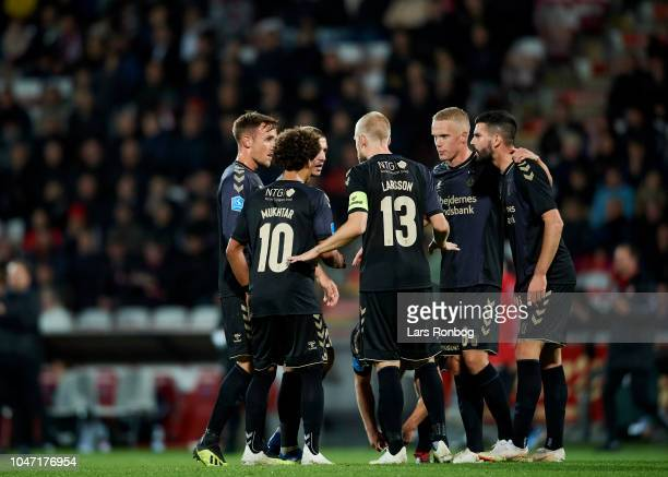The players of Brondby IF huddle during the Danish Superliga match between AaB Aalborg and Brondby IF at Aalborg Portland Park on October 7 2018 in...