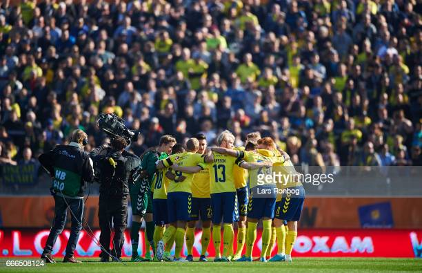 The players of Brondby IF huddle in front of their fans prior to the Danish Alka Superliga match between Lyngby BK and Brondby IF at Lyngby Stadion...