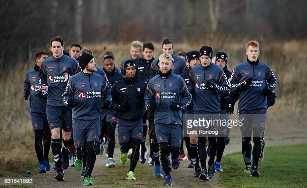 The players of Brondby IF running on to the pitch prior to the Brondby IF training session at Brondby Stadion on January 12 2017 in Brondby Denmark
