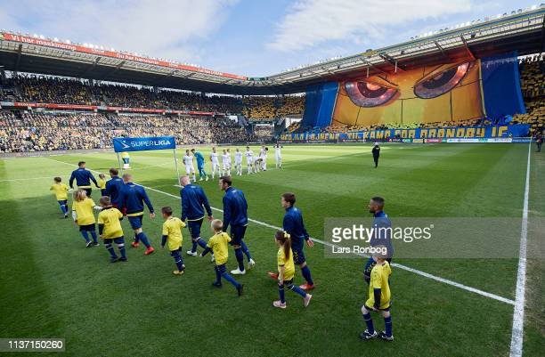 The players of Brondby IF walks on to the pitch in front of the tifo prior to the Danish Superliga match between Brondby IF and FC Copenhagen at...