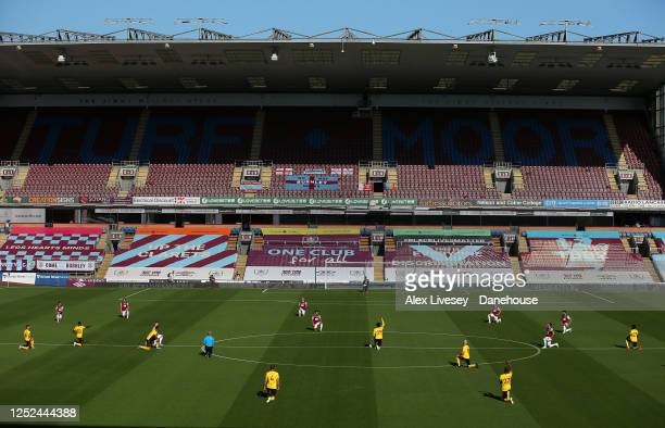 The players of Burnley FC and Watford FC take a knee in support of the Black Lives Matter movement prior to the Premier League match between Burnley...