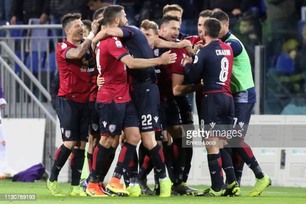 the players of Cagliari celebrate victory at the end of the Serie A match between Cagliari and ACF Fiorentina at Sardegna Arena on March 15 2019 in...