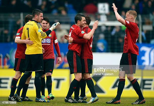 The players of Chemnitz celebrate after the third Bundesliga match between Stuttgarter Kickers and Chemnitzer FC at GAZI-Stadion on March 15, 2014 in...