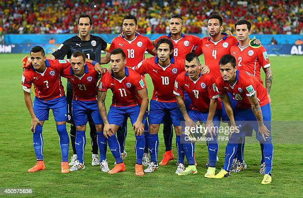 The players of Chile line up prior to the 2014 FIFA World Cup Brazil Group B match between Chile and Australia at Arena Pantanal on June 13 2014 in...