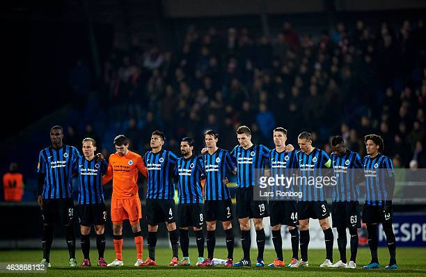 The players of Club Brugge show respect for the victims of the shooting in Copenhagen prior to the UEFA Europa League match between AaB Aalborg and...