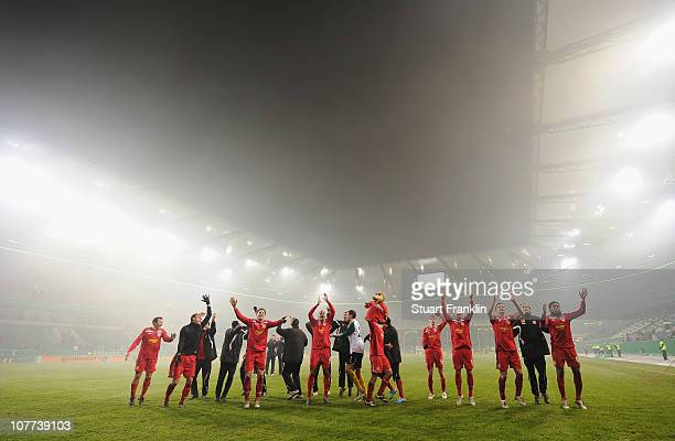 The players of Cottbus celebrate winning at the end of the DFB Cup last 16 match between VfL Wolfsburg and Energie Cottbus at the Volkswagen arena on...