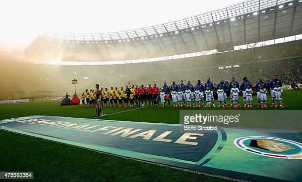 The players of Dortmund and Wolfsburg line up prior to the DFB Cup Final match between Borussia Dortmund and VfL Wolfsburg at Olympiastadion on May...