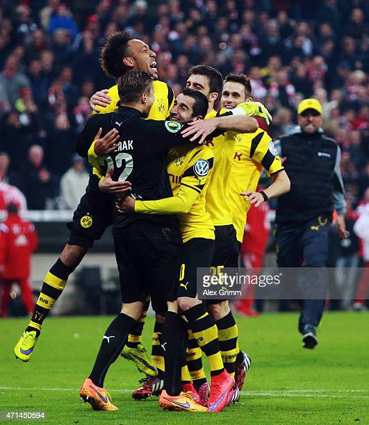 The players of Dortmund celebrate after winning during the penalty shoot out during the DFB Cup semi final match between FC Bayern Muenchen and...