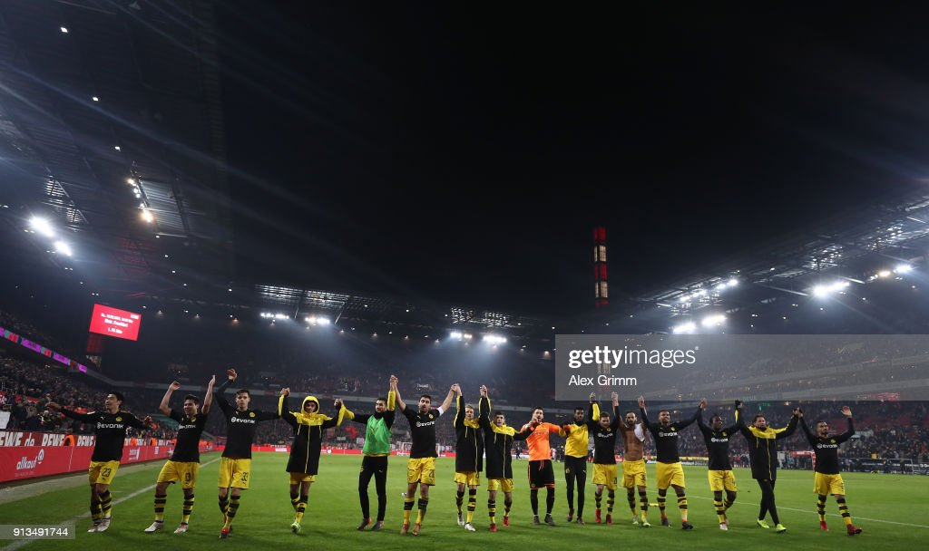 The players of Dortmund celebrate after winning the Bundesliga match between 1. FC Koeln and Borussia Dortmund at RheinEnergieStadion on February 2, 2018 in Cologne, Germany.