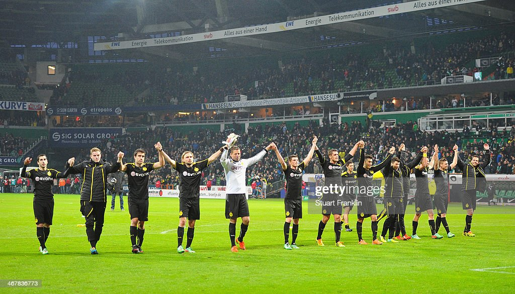 The players of Dortmund celebrate at th end of the Bundesliga match between Werder Bremen and Borussia Dortmund at Weserstadion on February 8, 2014 in Bremen, Germany.