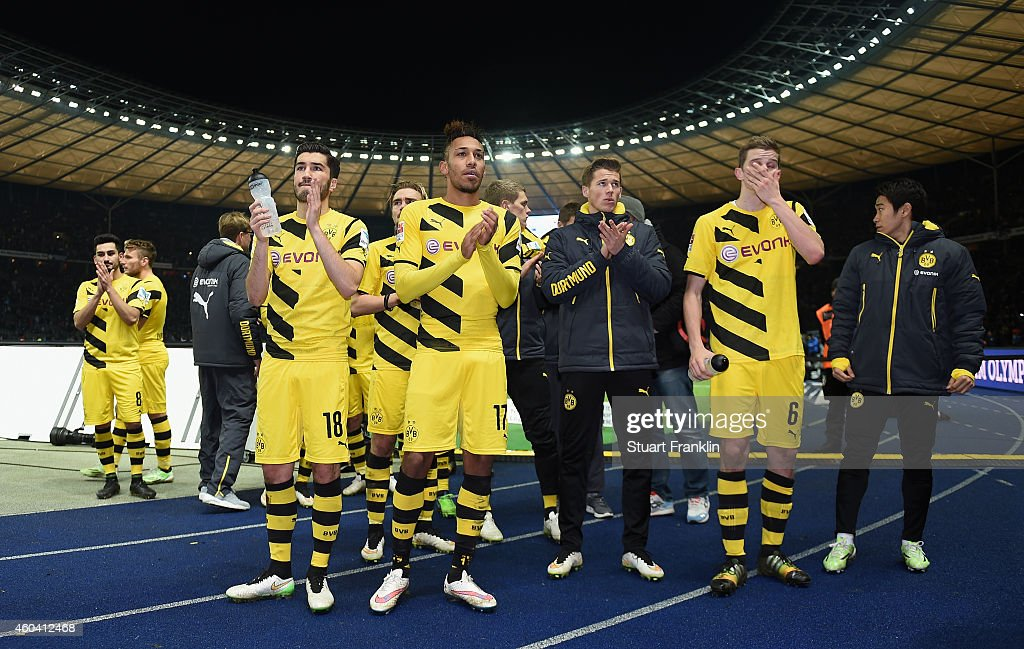 The players of Dortmund stand before the fans at tht end of the Bundesliga match between Hertha BSC and Borussia Dortmund at Olympiastadion on December 13, 2014 in Berlin, Germany.