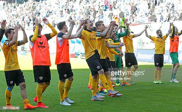 The players of Dresden celebrate with their supporters after winning the third league match between FC Hansa Rostock and SG Dynamo Dresden at...