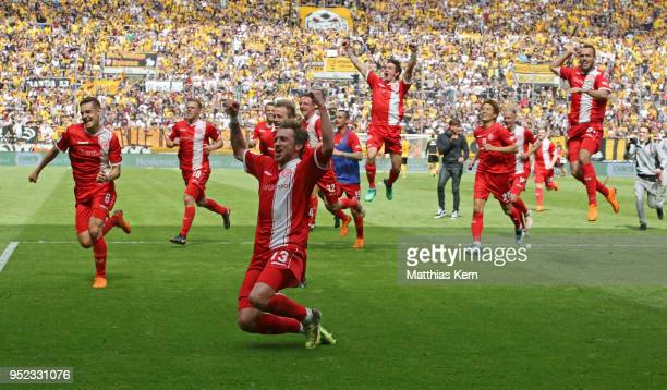 The players of Duesseldorf jubilate after moving into the Bundesliga after the Second Bundesliga match between SG Dynamo Dresden and Fortuna...