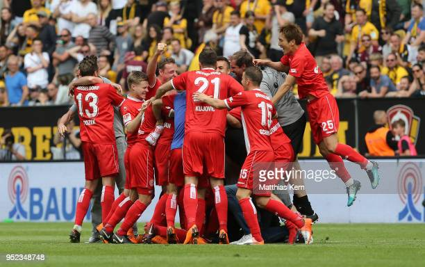 The players of Duesseldorf jubilate after moving up into the Bundesliga after the Second Bundesliga match between SG Dynamo Dresden and Fortuna...