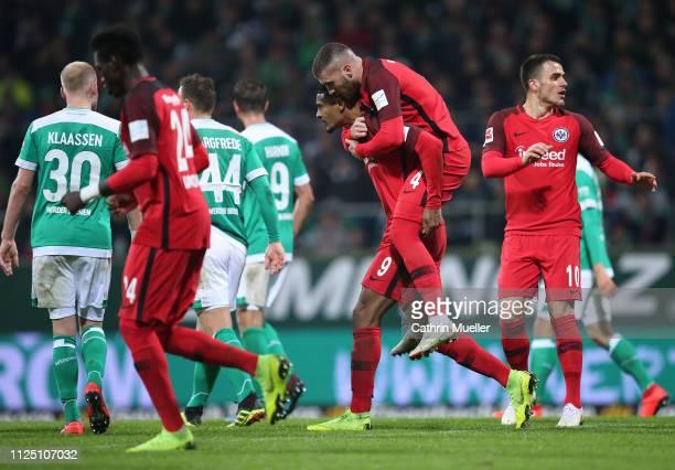The players of Eintracht Frankfurt celebrate after scoring during the Bundesliga match between SV Werder Bremen and Eintracht Frankfurt at...