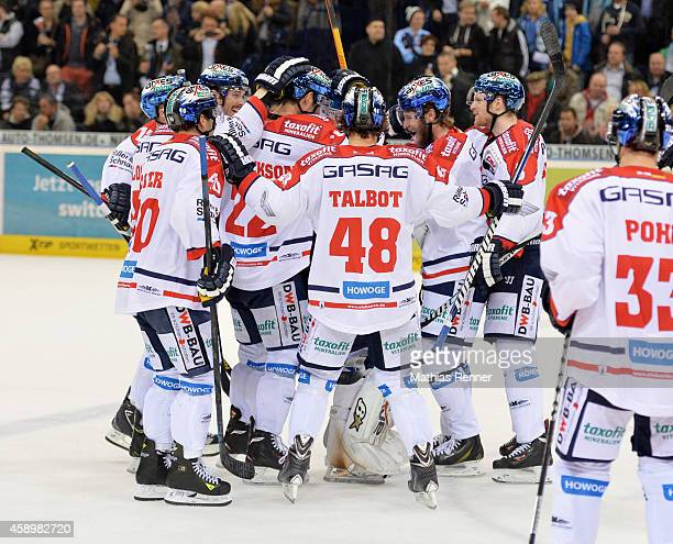 The players of Eisbaeren Berlin celebrate the victory during the game between Hamburg Freezers and Eisbaeren Berlin on november 14 2014 in Hamburg...