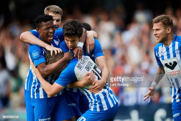 The players of Esbjerg fB celebrate after the 10 goal scored by Anders Dreyer of Esbjerg fB during the Danish Alka Superliga Playoff match between...
