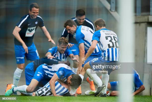 The players of Esbjerg fB celebrate after the 20 goal scored by Anders Dreyer of Esbjerg fB during the Danish Alka Superliga Playoff match between...