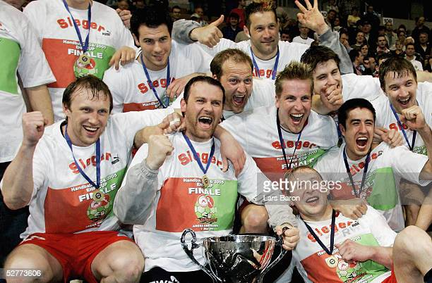 The players of Essen celebrates winning the cup after the EHF Cup Final between Tusem Essen and SC Magdeburg on May 7 2005 in Essen Germany