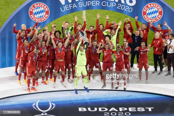 the player's of FC Bayern Muenchen celebrate after winning the UEFA Super Cup match between FC Bayern Munich and FC Sevilla at Puskas Arena on...