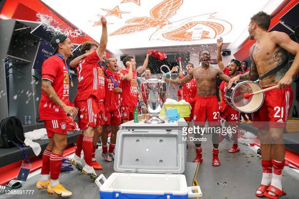 The players of FC Bayern Muenchen celebrate in the dressing room following their team's victory in the UEFA Champions League Final match against...