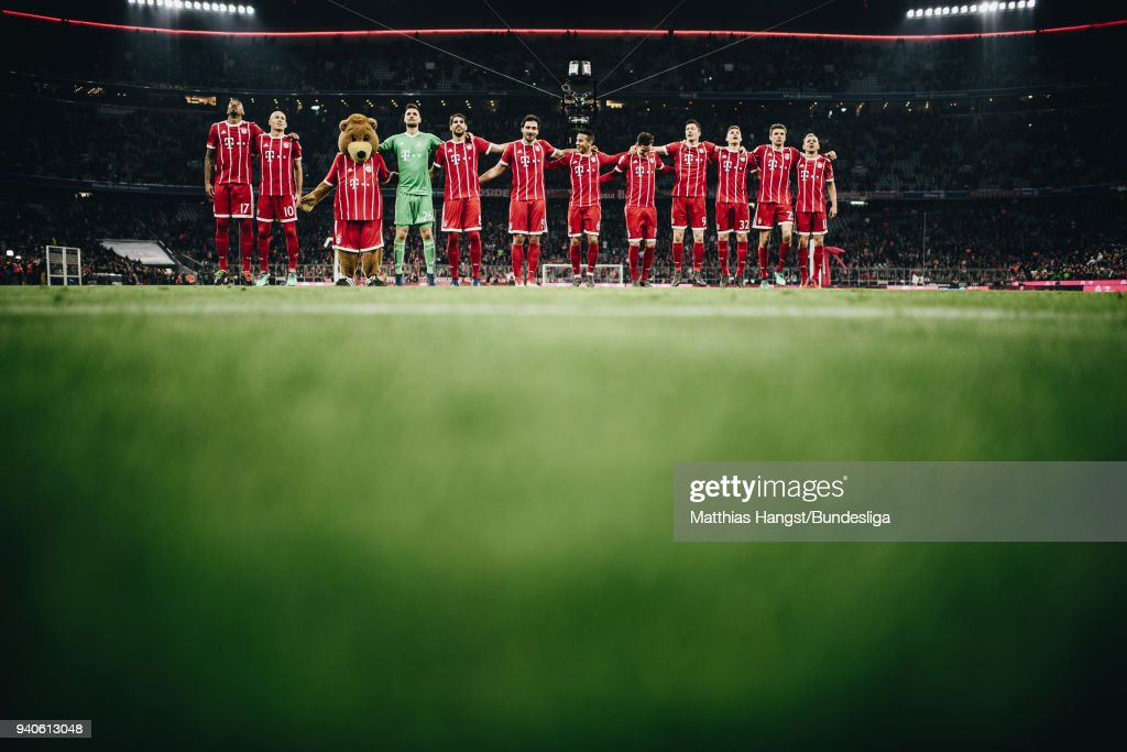 The players of FC Bayern Muenchen celebrate with the fans after the Bundesliga match between FC Bayern Muenchen and Borussia Dortmund at Allianz Arena on April 1, 2018 in Munich, Germany.