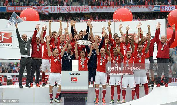 The players of FC Bayern Muenchen celebrate with the Meisterschale after the Bundesliga match between FC Bayern Muenchen and Hannover 96 at Allianz...