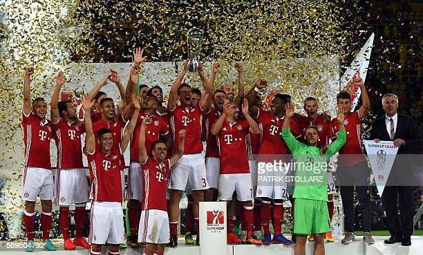 The players of FC Bayern Munich celebrate with the trophy after their 20 win during the German Super Cup football match final Borussia Dortmund vs FC...