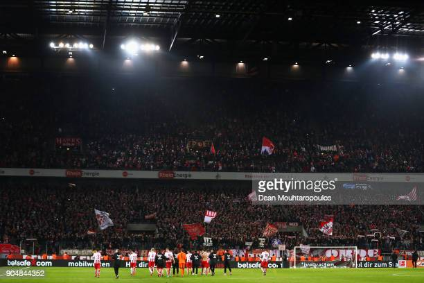 The players of FC Koeln celebrate victory after the Bundesliga match between 1 FC Koeln and Borussia Moenchengladbach at RheinEnergieStadion on...