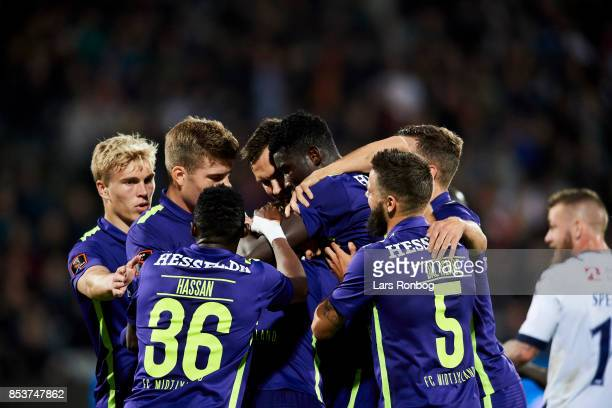 The players of FC Midtjylland celebrate after the 10 goal scored by Paul Onuachu during the Danish Alka Superliga match between AGF Aarhus and FC...