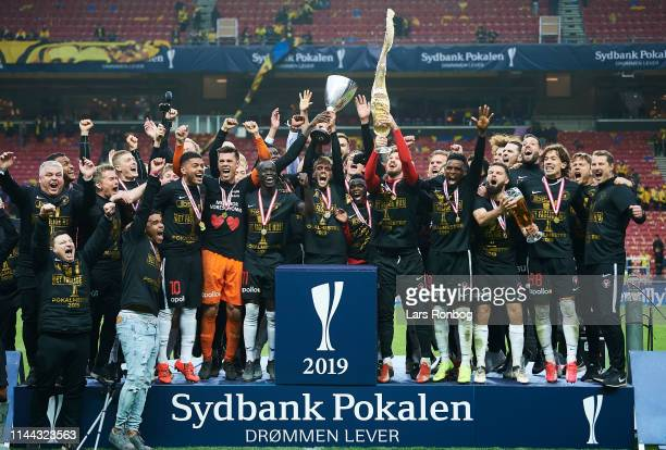 The players of FC Midtjylland lifting the trophy as cup winners after the Danish Cup Final Sydbank Pokalen match between Brondby IF and FC...