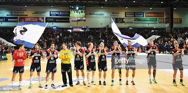 The players of Flensburg celebrate at the end of the Bundesliga handball game between SG FlensburgHandewitt and SG BBM Bietigheim at the Flens...