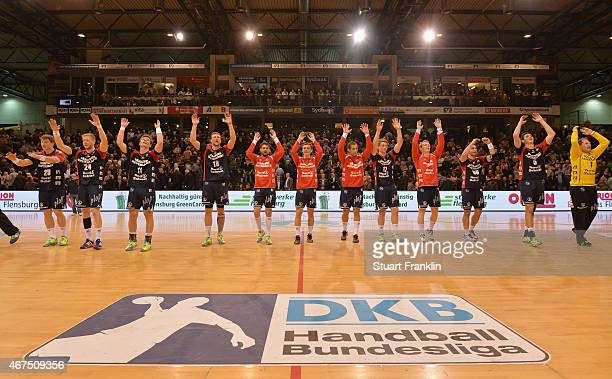 The players of Flensburg celebrate their win after the DKB Bundesliga handball match between SG FlensburgHandewitt and FA Goeppingen on March 25 2015...