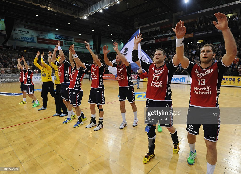 The players of Flensburg celebrates at the end of the DHB cup game between SG Flensburg Handewitt and Rhein-Neckar Loewen at the Flens Arena on February 5, 2013 in Flensburg, Germany.