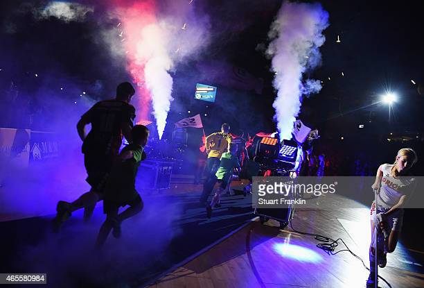 The players of Flensburg run onto the court during the Bundesliga handball game between SG FlensburgHandewitt and SG BBM Bietigheim at the Flens...