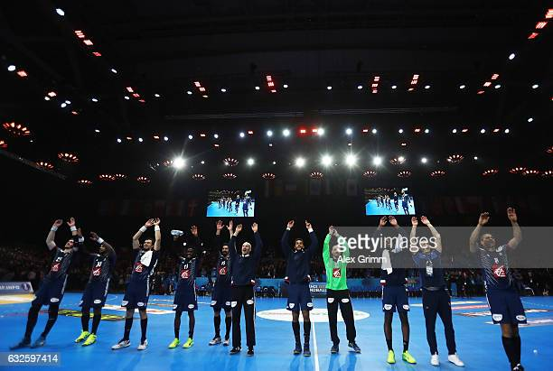 The players of France celebrate after winning the 25th IHF Men's World Championship 2017 Quarter Final match between France and Sweden at Stade...
