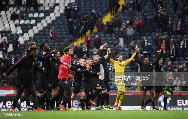 The players of Frankfurt celebrate with the fans after the Bundesliga match between Eintracht Frankfurt and 1 FC Nuernberg at CommerzbankArena on...