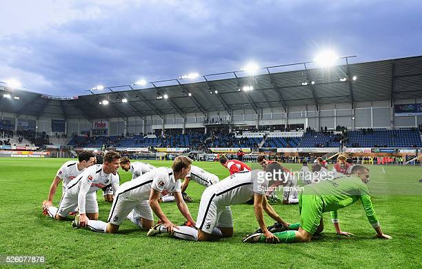 The players of Freiburg celebrate promotion to the first Bundesliga after the second Bundesliga match between SC Paderborn and SC Freiburg at the...