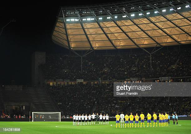 The players of Germany and Sweden line up at the start of the FIFA 2014 World Cup qualifier group C match between German and Sweden at Olympiastadion...