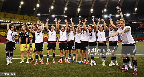 The players of Germany celebrate winning the quarter final match of the FIFA Women's World Cup between Germany and France at Olympic Stadium on June...